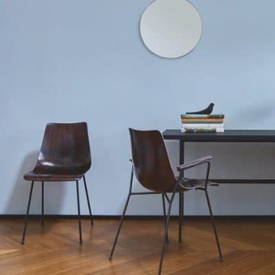 Tanis desk and CM131 dining chair by Pierre Paulin for Ligne Roset. Sperl gold mirror in pale blue wall