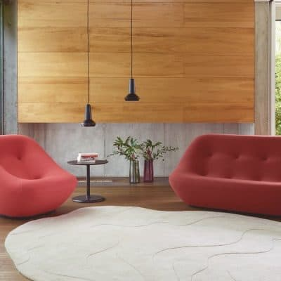 ierre Paulin Bonnie armchair and sofa in terracotta tones with his Gavrinis 3 rug design, Amy de Jean pendant light
