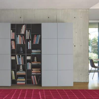 Book&Look storage unit, Quadric rug in Bordeaux wool. Odessa round marble dining table to rear